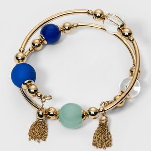 Gold & Blue Coiled Bracelet With Tassels